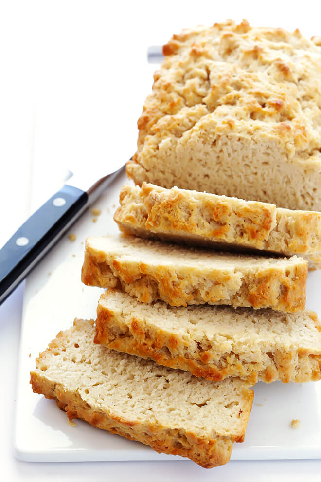My all-time favorite beer bread recipe is SO easy to make! All you need are 6 ingredients, and this honey-sweetened bread will be ready to go in less than an hour. | gimmesomeoven.com