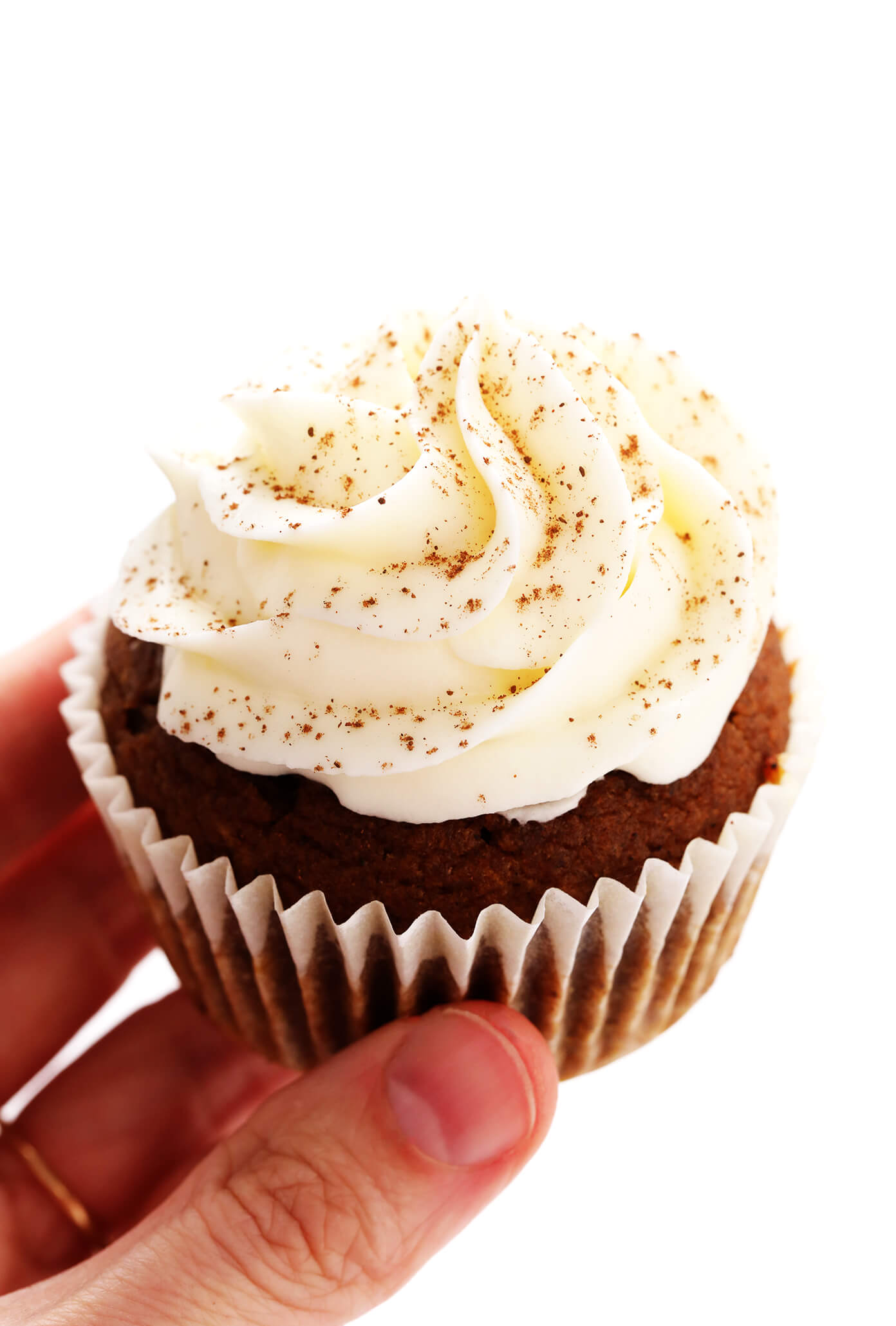 Holding a Pumpkin Cupcake with Cream Cheese Frosting