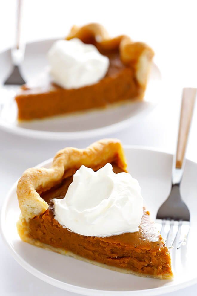 This Bourbon Pumpkin Pie recipe is made with a splash of whiskey, and topped with a delicious bourbon whipped cream topping.  It's the perfect dessert for Thanksgiving!