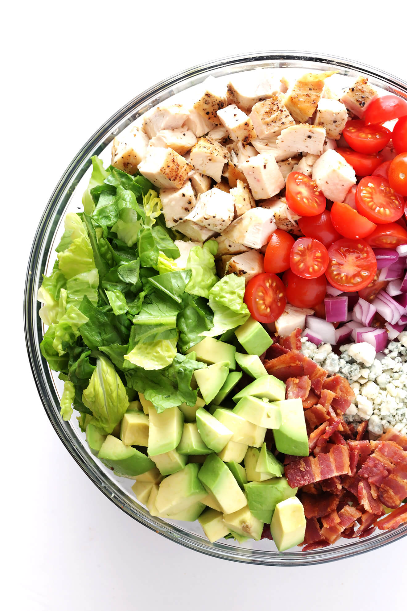 This Chicken, Bacon and Avocado Chopped Salad is made with the most delicious savory ingredients, including lots of blue cheese and a yummy red wine vinaigrette. | gimmesomeoven.com
