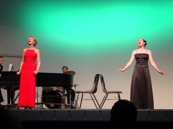 Monica and me, circa 2005, belting out a duet at her senior recital.