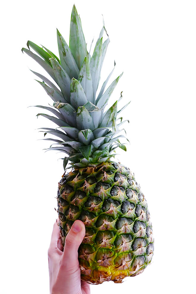 Learn how to cut a pineapple with this step-by-step video, plus tips on how to select, store, and cook with fresh pineapple! | gimmesomeoven.com