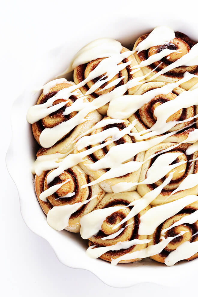 This 1-Hour Cinnamon Roll recipe is totally easy to make, and topped with the most delicious cream cheese frosting. Step-by-step photo and video tutorials are included too! | gimmesomeoven.com