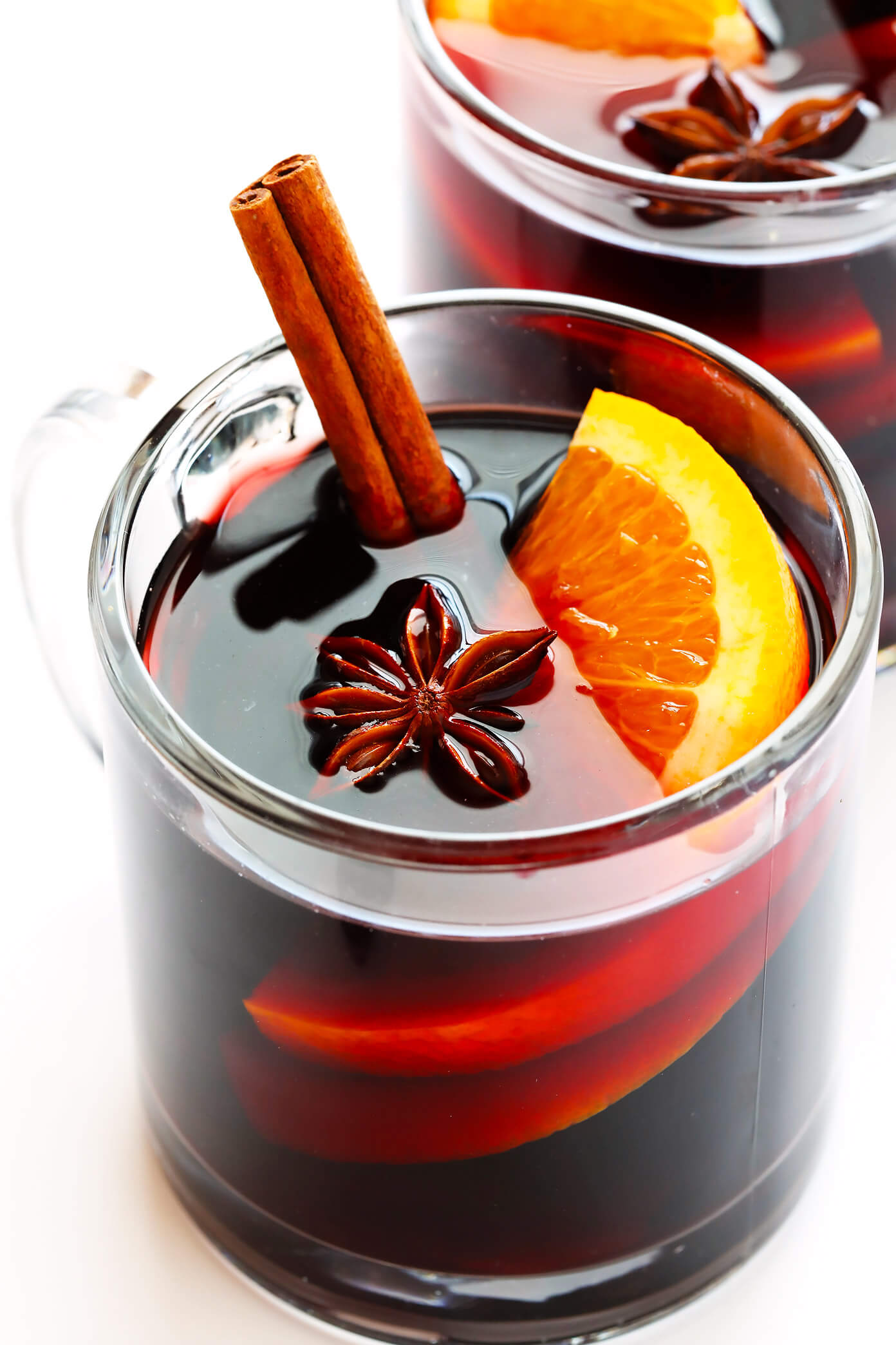 This is the BEST Mulled Wine recipe! It's easy to make on the stovetop or in the slow cooker, it's lightly sweetened and simmered with cinnamon, spices and orange, and it's the perfect drink to warm you up in the wintertime. Perfect for holiday entertaining and more!