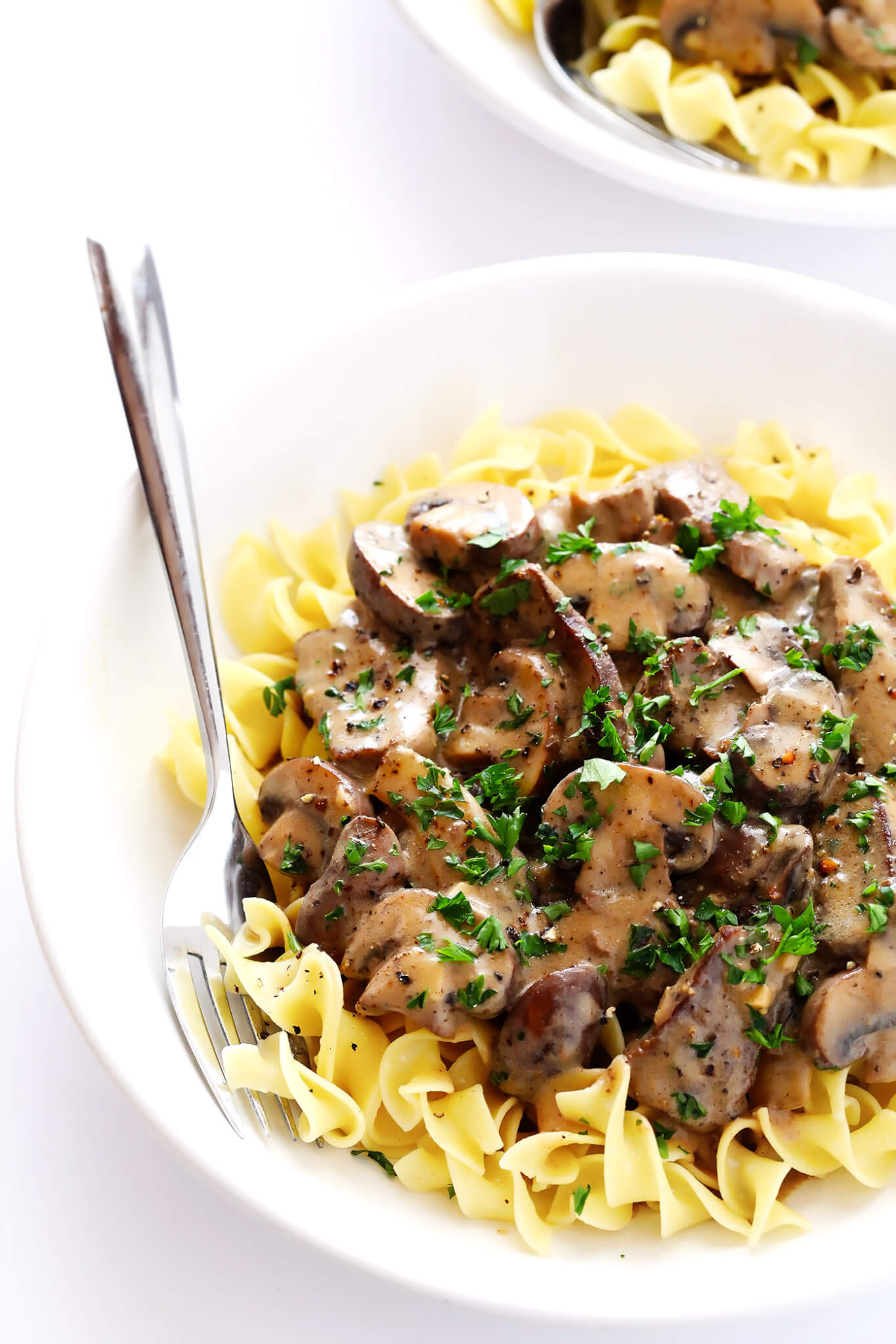 This 30-Minute Beef Stroganoff recipe is quick and easy to make, full of creamy steak and mushrooms, and SO savory and delicious! Feel free to serve over pasta, or rice, zucchini noodles -- you name it.