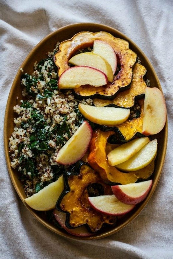 Roasted Acorn Squash and Apples with Quinoa, Kale, and Maple Tahini Dressing | edibleperspective.com