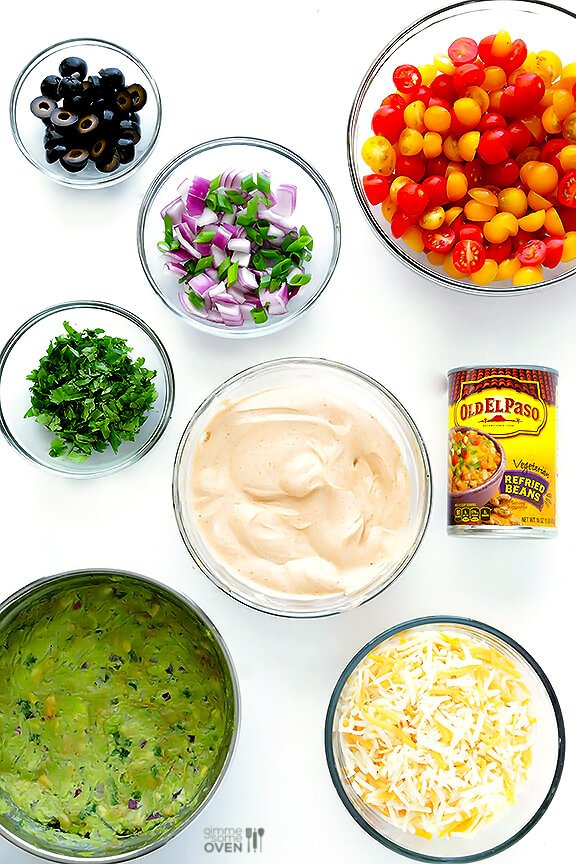7 Layer Dip -- a fresh recipe for this classic dip that's always a crowd-pleaser! | gimmesomeoven.com #appetizer #gameday
