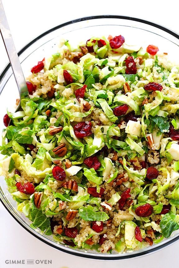 Shredded brussels sprouts, quinoa and cranberries make this EPIC fall salad!! -- PLUS 30 other thanksgiving side dish recipes for your holiday