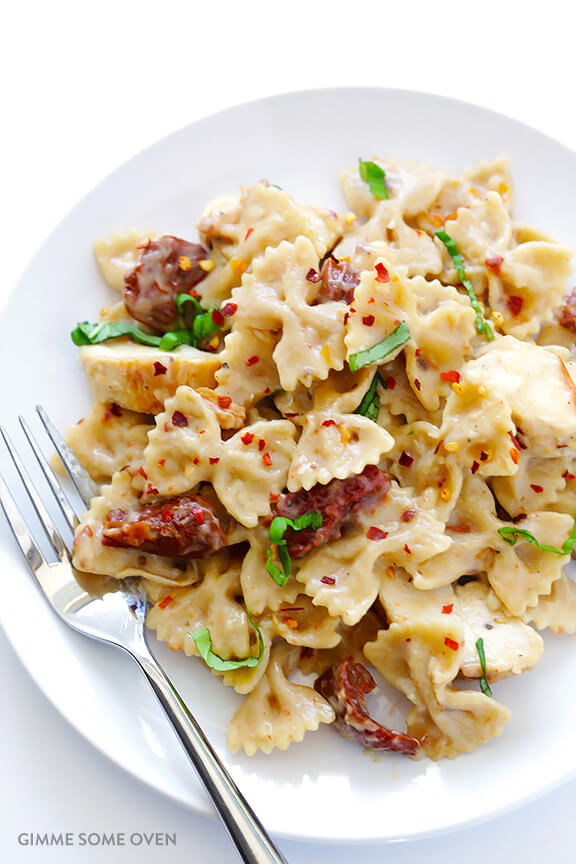 Creamy Pasta with Chicken & Sun-Dried Tomatoes -- ready to go in 30, and made with a lightened-up sauce | gimmesomeoven.com