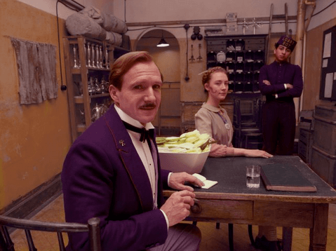 Ralph Fiennes, Saoirse Ronan and Tony Revolori in Wes Anderson's The Grand Budapest Hotel. Photo by Bob Yeoman - © 2014 - Fox Searchlight Pictures