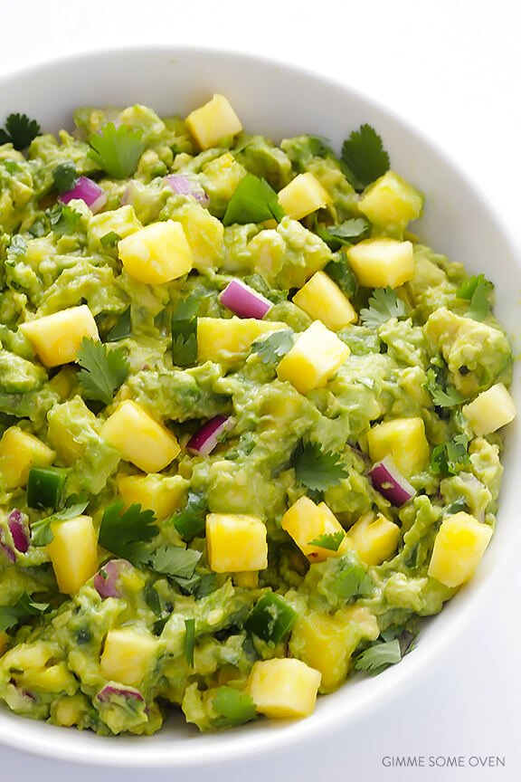 Pineapple Guacamole Recipe -- all of the goodness of this classic dip, sweetened up with some fresh pineapple! | gimmesomeoven.com