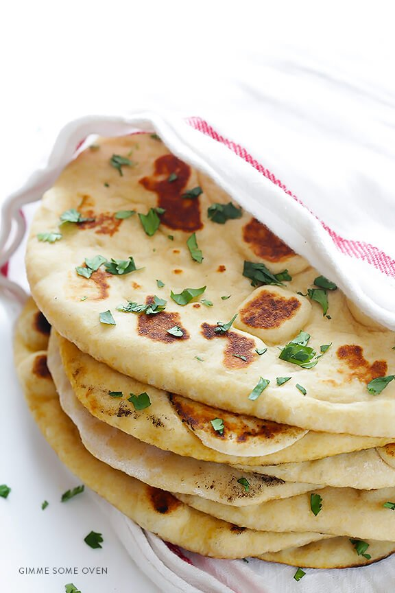 Learn how to make homemade naan (Indian flatbread) with this simple and delicious recipe!   gimmesomeoven.com
