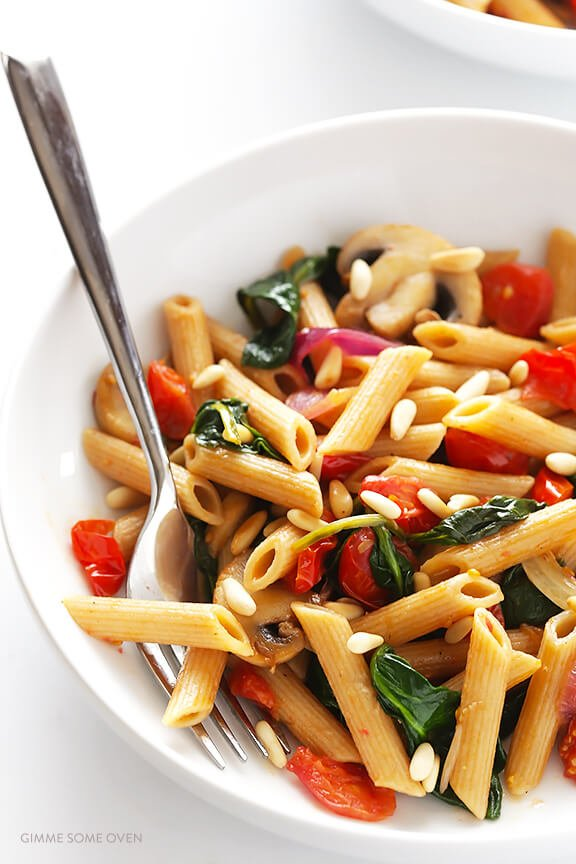 Pasta with Mushrooms Tomatoes and Spinach -- easy to make, and tossed with a delicious white wine garlic sauce | gimmesomeoven.com