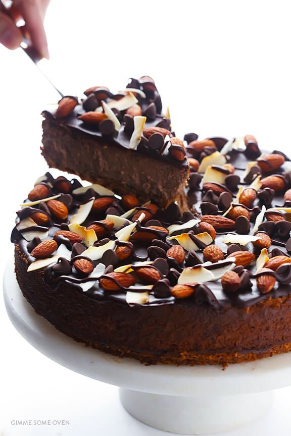 Almond Joy Cheesecake -- made with an easy almond crust, and naturally gluten-free! | gimmesomeoven.com
