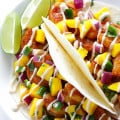 Easy Mango Shrimp Tacos -- absolutely delicious, and ready to go in about 20 minutes! | gimmesomeoven.com