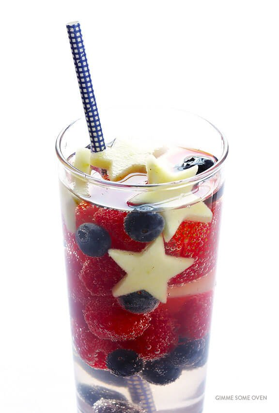 This Sparkling Patriotic Sangria is perfect for 4th of July or Memorial Day!  Made with fresh berries and sparkling white wine, it's an easy and delicious cocktail that everyone will love. | gimmesomeoven.com