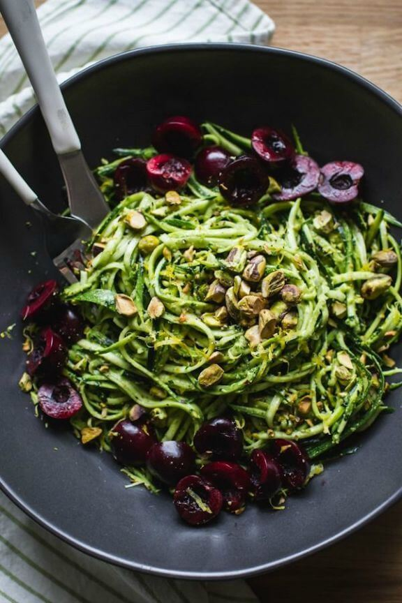 Pistachio Kale Pesto with Zucchini Noodles + Cherries | edibleperspective.com
