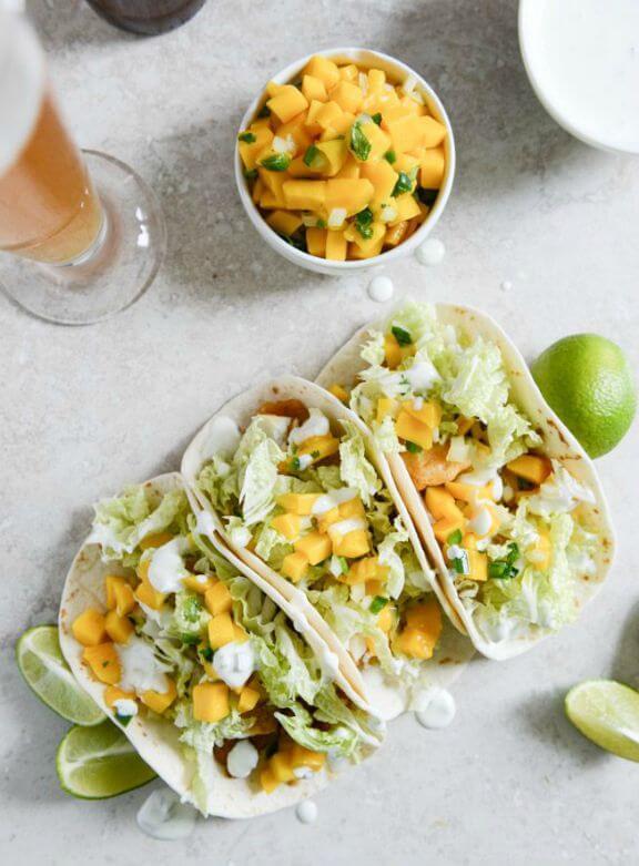 Beer Battered Fish Tacos with Margarita Mango Salsa and Jalapeño Crema | howsweeteats.com