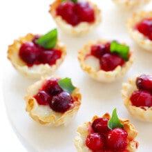 Super-Easy Cranberry Baked Brie Bites Recipe -- the perfect appetizer for holiday parties or anytime you're craving savory and sweet! | gimmesomeoven.com