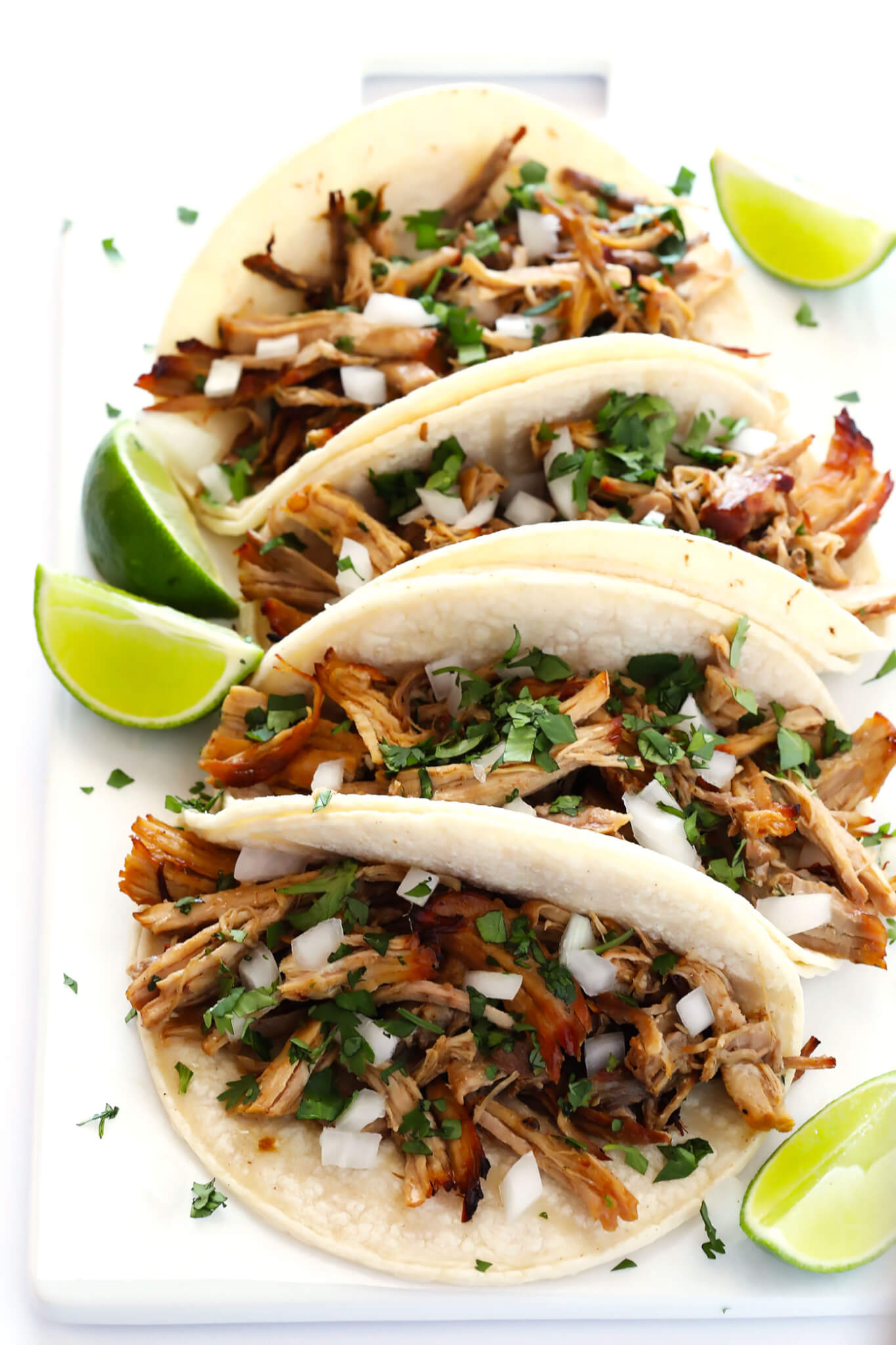 The BEST Slow Cooker Pork Carnitas! They're easy to make in the crock pot, made with my favorite Mexican seasonings, and so crispy and delicious! Perfect for tacos, enchiladas, salads, burritos, quesadillas and more. | gimmesomeoven.com