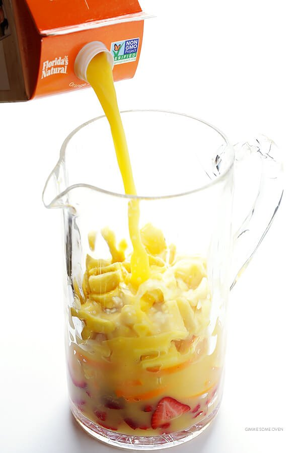 Mimosa Sangria -- quick and easy to make, and kicked up a notch with lots of delicious fresh fruit! | gimmesomeoven.com