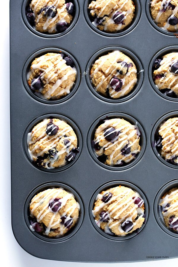 Healthier Blueberry Muffins -- made with white whole wheat flour, naturally sweetened, and SO fluffy and buttery and delicious! | gimmesomeoven.com