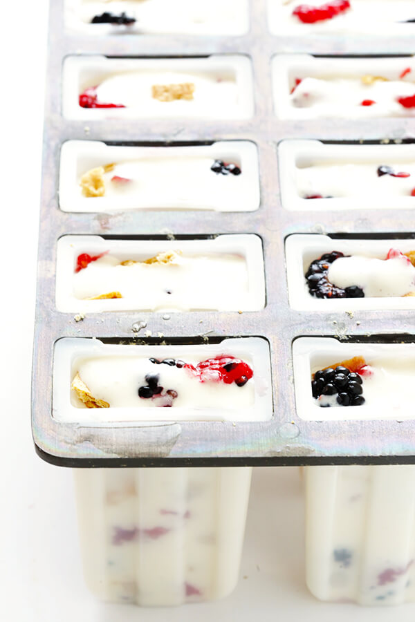 These Berry Cheesecake Popsicles are quick and easy to prep, they're chocked full of fresh berries and graham crackers, and they really do taste like cheesecake! | gimmesomeoven.com