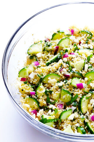 This Cucumber Quinoa Salad is made with lots of fresh basil and feta, tossed with a simple lemony vinaigrette, and it's SO fresh and delicious! Plus, it's naturally gluten-free and quick and easy to make. | gimmesomeoven.com