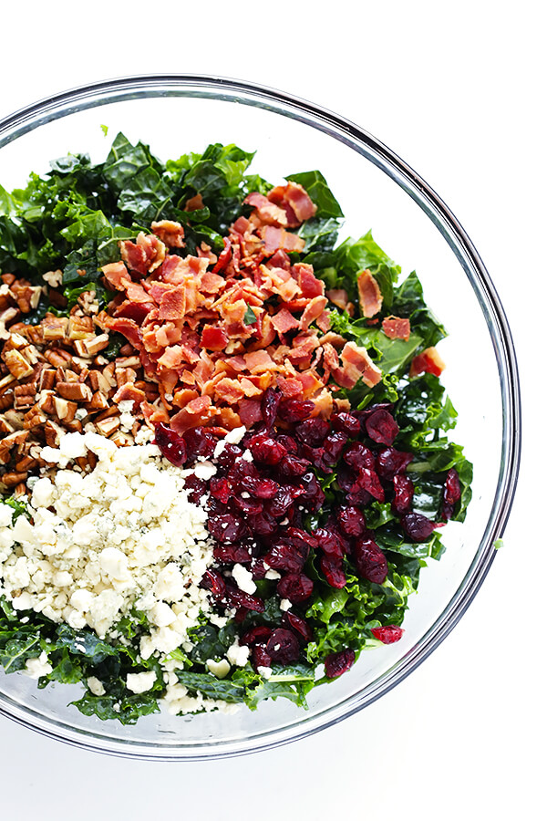 This Kale Salad with Bacon and Blue Cheese is quick and easy to make, tossed with a red wine shallot vinaigrette, and TOTALLY delicious. (Bonus, it holds up for hours in the fridge, if you want to make it ahead of time!) | gimmesomeoven.com