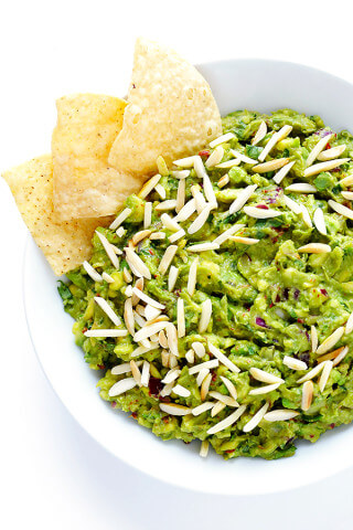 This Toasted Almond and Chipotle Guacamole recipe is easy to make in about 10 minutes, and it's absolutely IRRESISTIBLE.  Trust me. | gimmesomeoven.com (Vegan + Gluten Free)