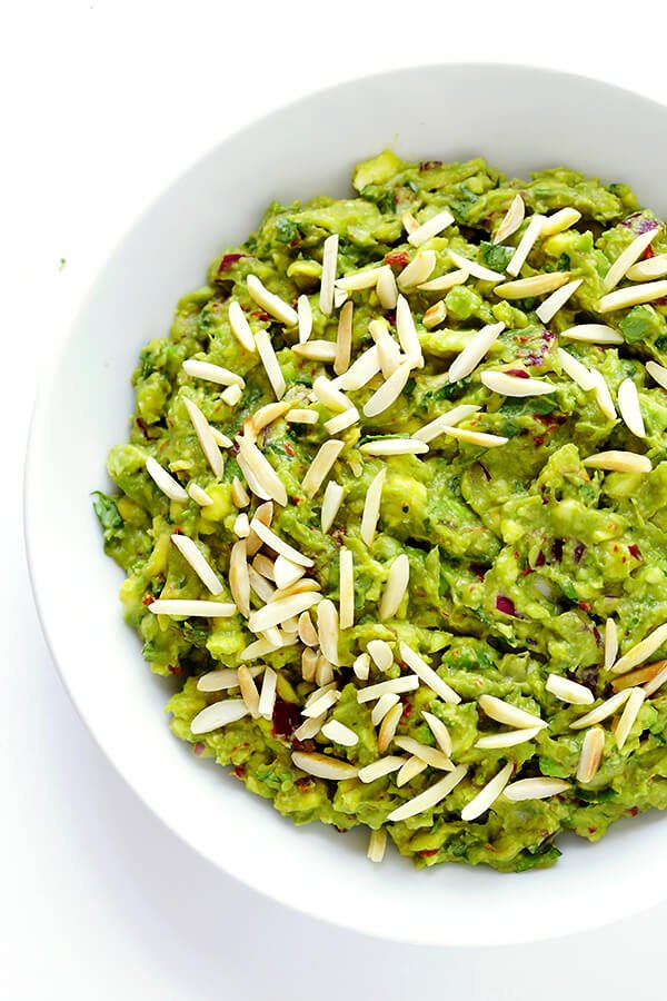This Toasted Almond Chipotle Guacamole recipe is ridiculously delicious...and always a crowd favorite! | gimmesomeoven.com (Appetizer / Dip / Gluten-Free / Vegan)