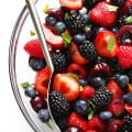 This Very Berry Fruit Salad recipe is a fantastic way to use up leftover fruit. Plus it just takes a few minutes to make, and tastes delicious with a hint of honey and fresh mint. | gimmesomeoven.com
