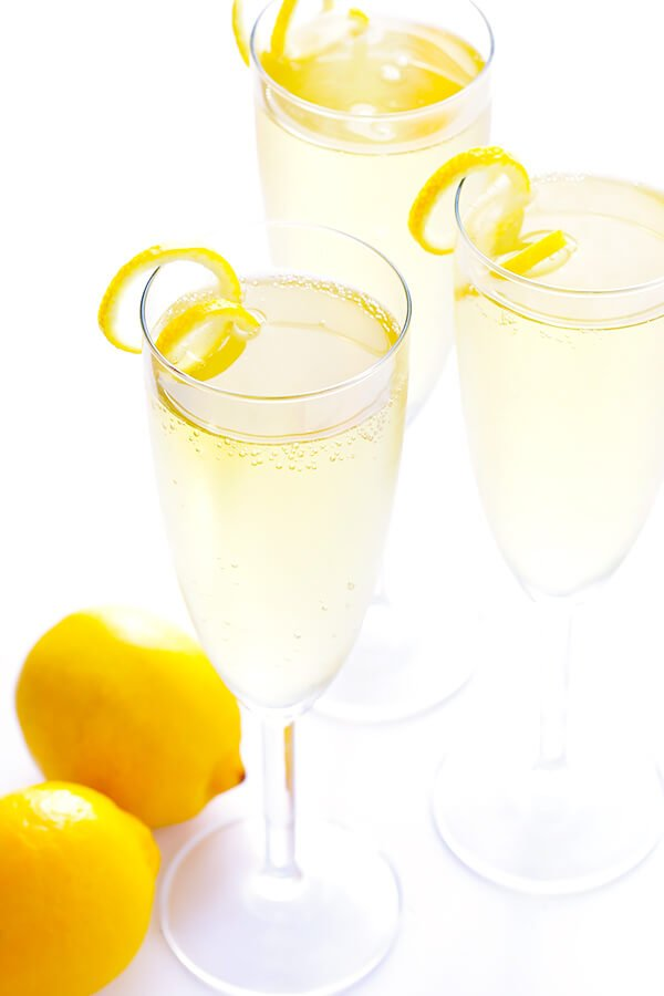 This classic French 75 cocktail recipe is made with sparkling champagne, gin, fresh lemon juice, and lightly sweetened with sugar (or honey) simple syrup. So delicious and refreshing! | gimmesomeoven.com