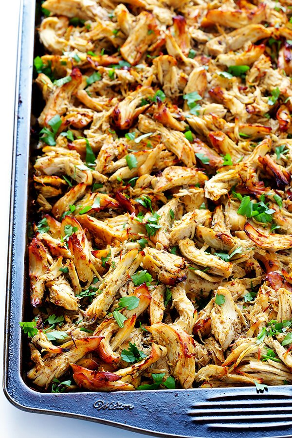 These Slow Cooker Crispy Chicken Carnitas are made easy by simmering for hours in the crock pot, then they're briefly crisped up in the broiler, resulting in tender, crispy, juicy, and absolutely DELICIOUS chicken carnitas. Perfect for tacos, burritos, or whatever sounds good! | gimmesomeoven.com
