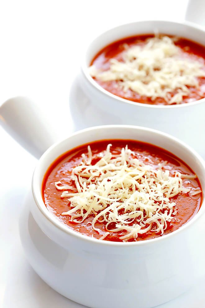 This 20-Minute Tomato Soup recipe is quick and easy to make, made with lots of fresh basil and garlic, and absolutely delicious! | gimmesomeoven.com (Vegan / Vegetarian / Gluten-Free)