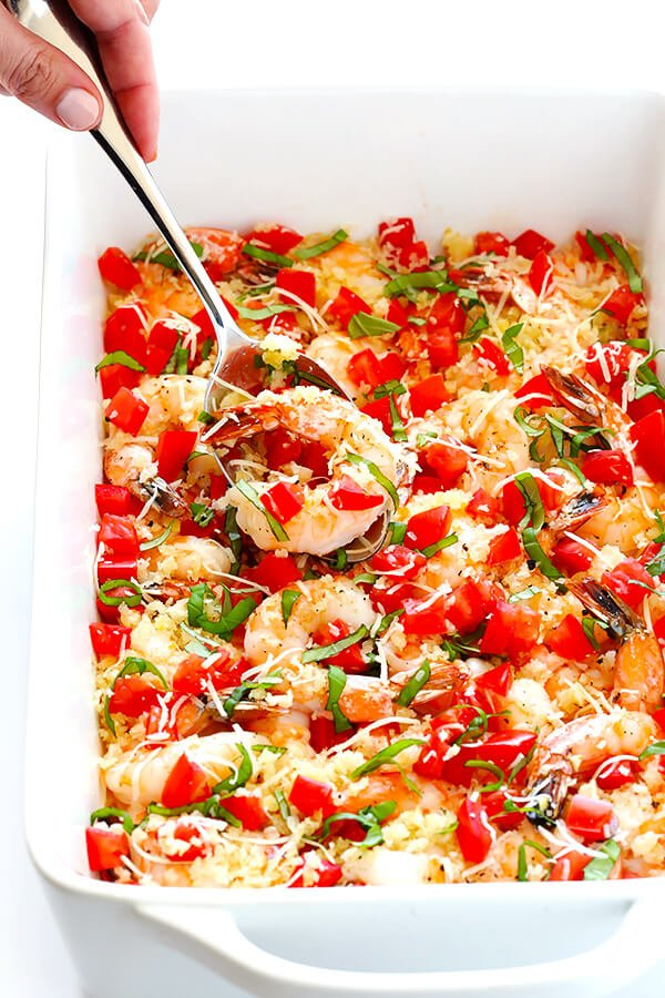 This Bruschetta Baked Shrimp recipe is ready to go in less than 25 minutes, topped with garlicky breadcrumbs and all of the delicious flavors of fresh bruschetta.   gimmesomeoven.com