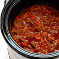 This Slow Cooker Beef Ragu is quick and easy to prep, and slow-simmered in the most AMAZING tomato sauce. Serve it over pasta, polenta, or whatever sounds good. | gimmesomeoven.com