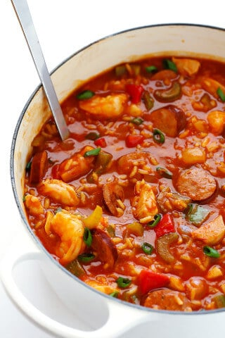 This Jambalaya Soup recipe can be made with shrimp, chicken, Andouille sausage -- or all three! It's easy to make, and so hearty and delicious. | gimmesomeoven.com
