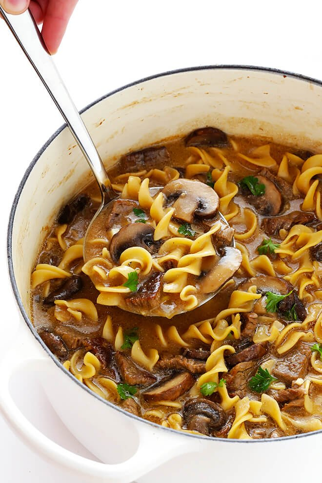 This Beef Stroganoff Soup recipe is easy to make, full of tender beef and noodles, and an absolutely delicious dinner! | gimmesomeoven.com