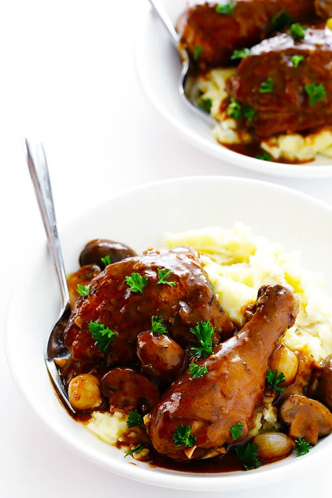 This classic Coq Au Vin recipe is surprisingly easy to make, and slow simmered in the most delicious French red wine sauce. | gimmesomeoven.com