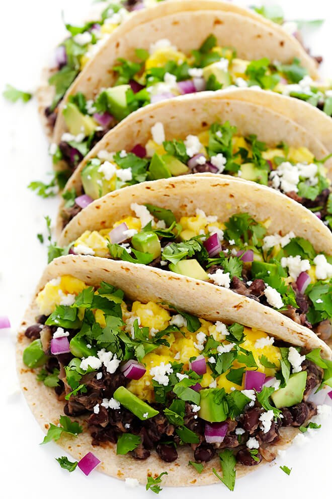 These easy Black Bean Breakfast Tacos are made with a zesty black bean filling, and you can top them with whatever you'd like! | gimmesomeoven.com