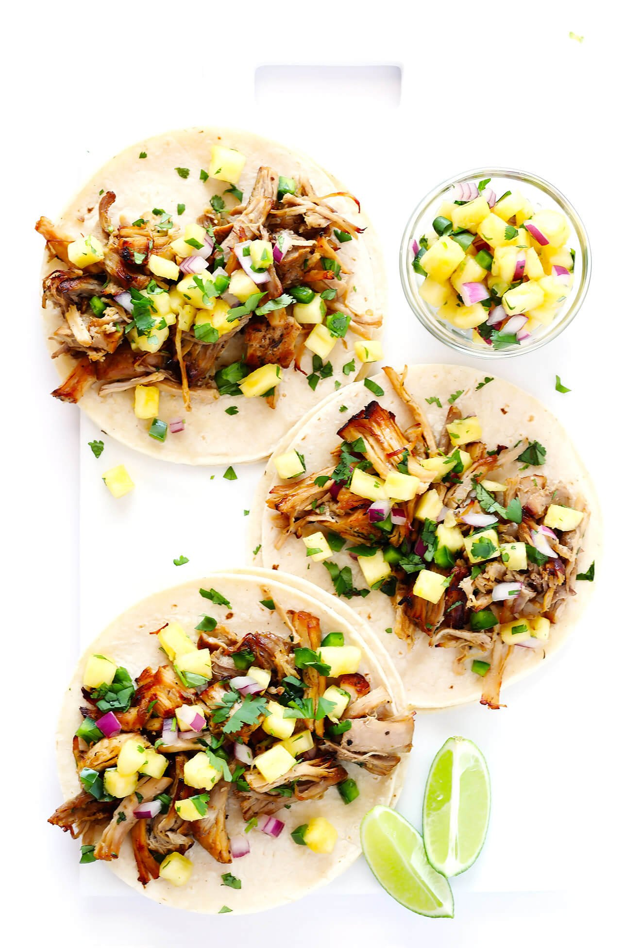 These Instant Pot Pork Carnitas Tacos are marinated in an easy mojo sauce, and SO delicious!   gimmesomeoven.com