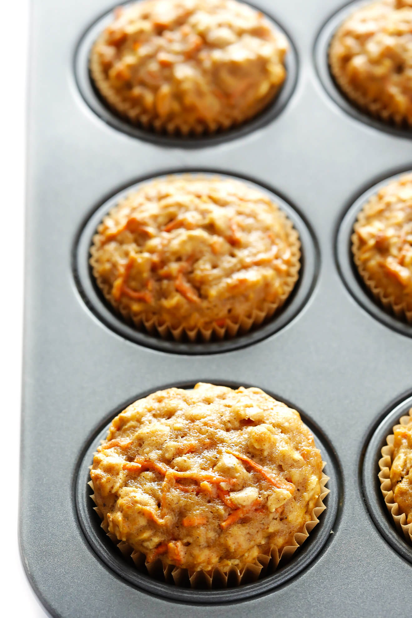 These Wholesome Carrot Muffins are easy to make, naturally sweetened with honey, and perfectly moist and delicious! | gimmesomeoven.com