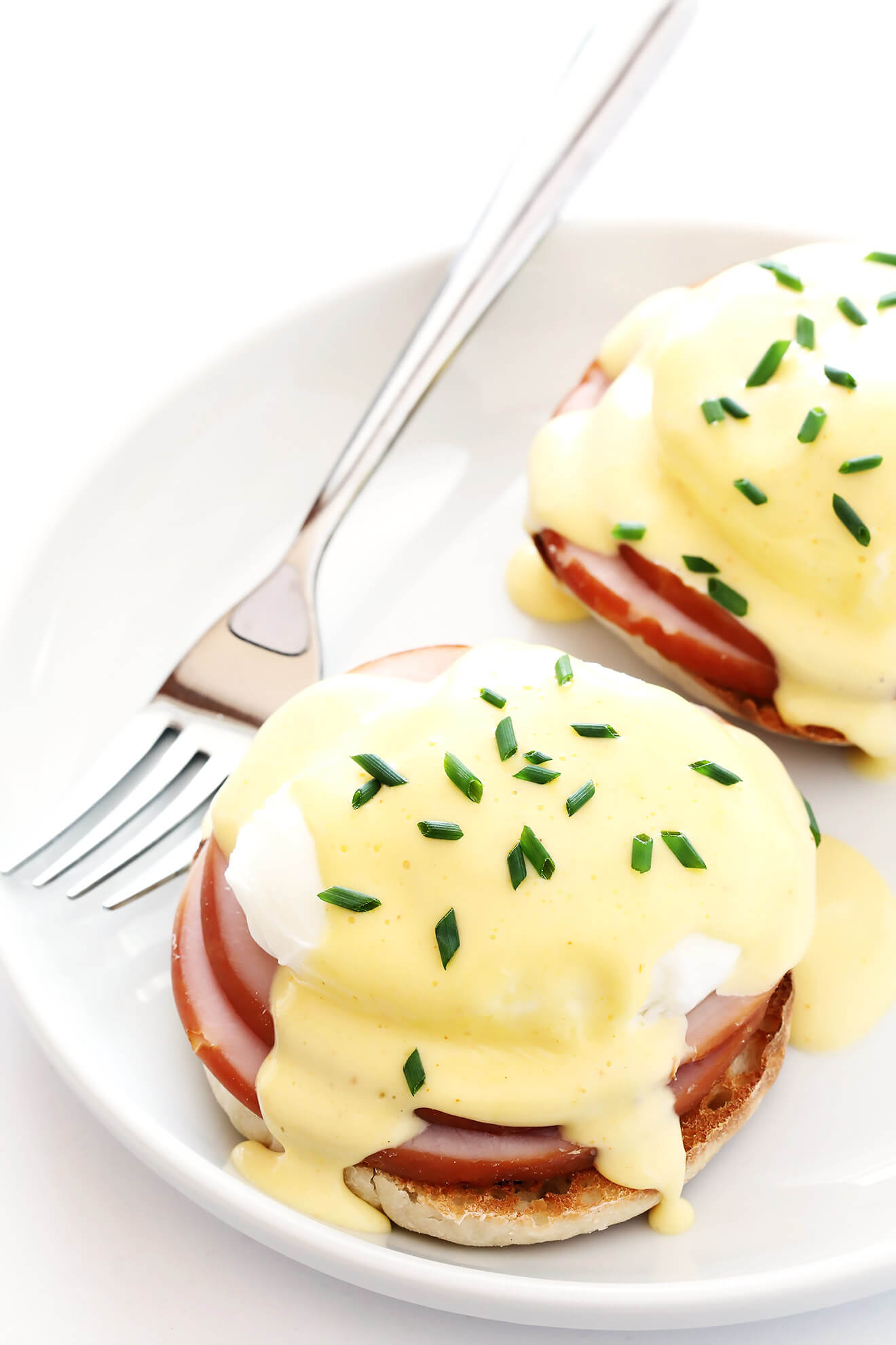 This is my favorite recipe for classic Eggs Benedict. The blender Hollandaise sauce is surprisingly easy to make, and so tasty! | gimmesomeoven.com