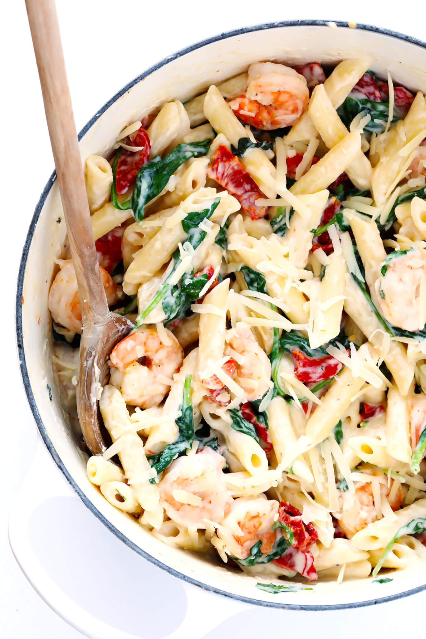 This Creamy Shrimp Florentine Pasta recipe is made with lots of Parmesan, sun-dried tomatoes and spinach, and tossed in a heavenly cream sauce. So delicious! | gimmesomeoven.com