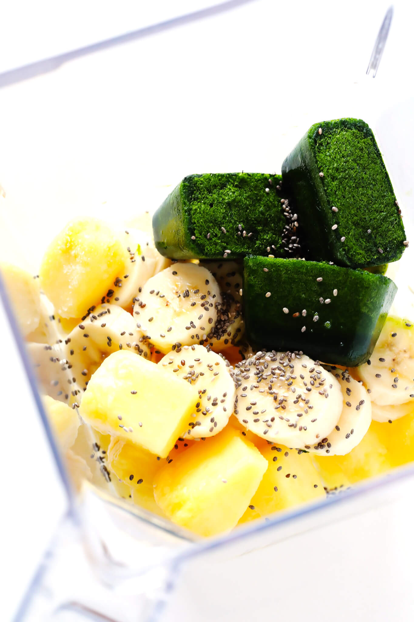 "Frozen Spinach Cubes are my favorite way to make a smoothie ""green""! Just puree baby spinach and coconut water until smooth, freeze, and add to just about any smoothie. 