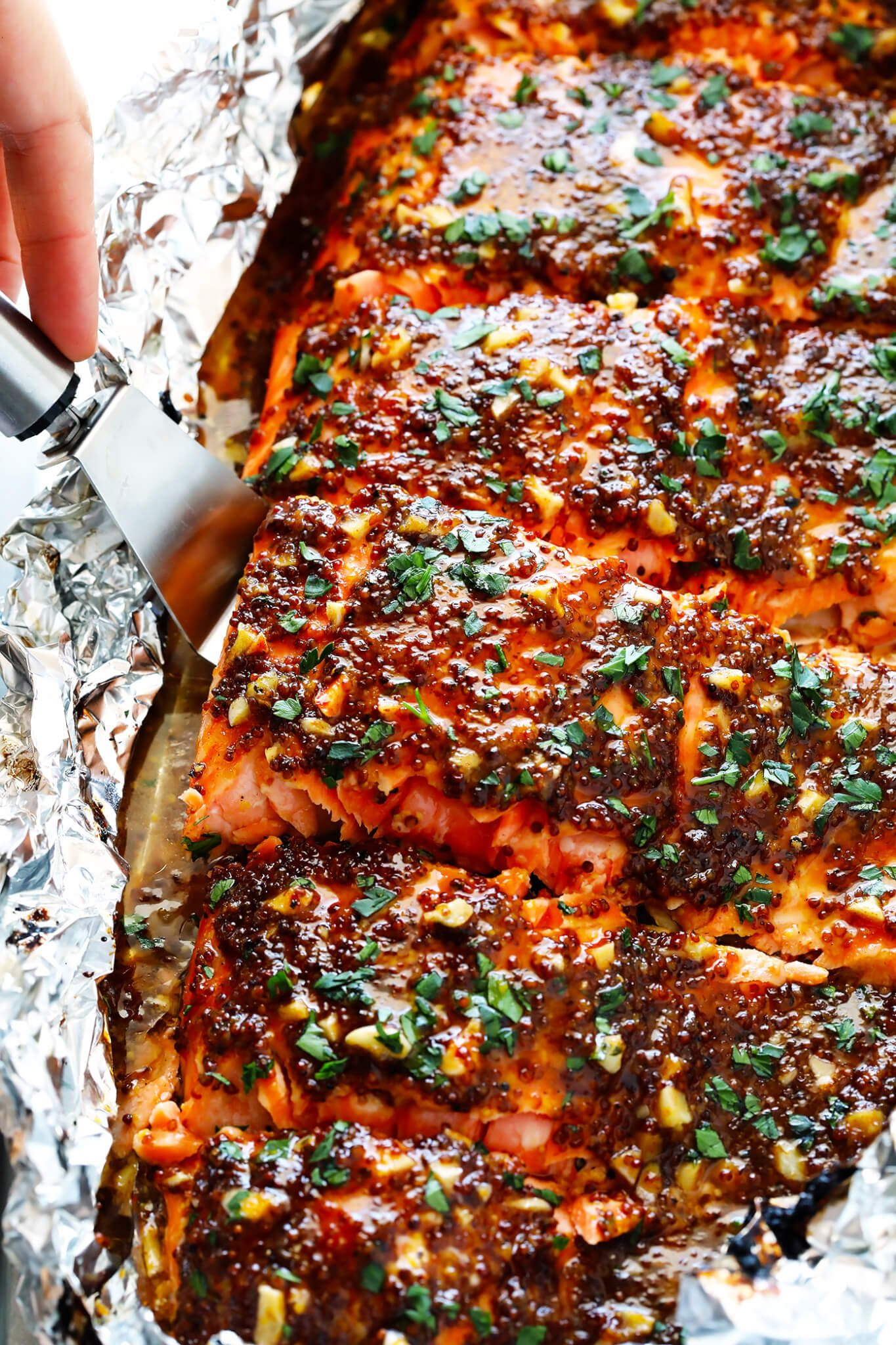 This 25-Minute Honey-Mustard Salmon In Foil recipe is the BEST. It's easy to make baked or grilled, it's full of great flavor, and it's always a crowd pleaser! | gimmesomeoven.com (Gluten-Free / Pescetarian)