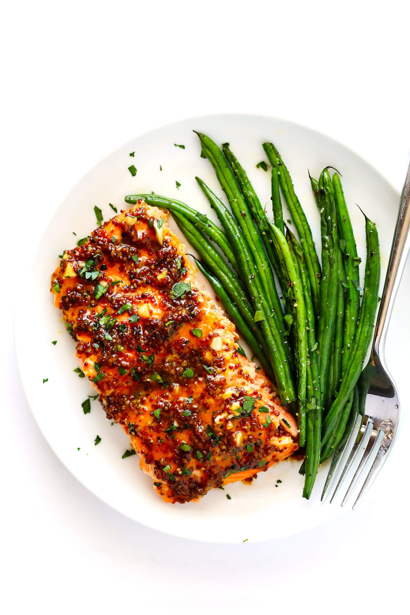 My favorite Honey-Mustard Salmon recipe!! It's made with an easy sauce full of whole grain mustard, honey, lemon juice, garlic and seasonings, and it's easy to bake in the oven or grill! | gimmesomeoven.com (Gluten-Free / Pescetarian)