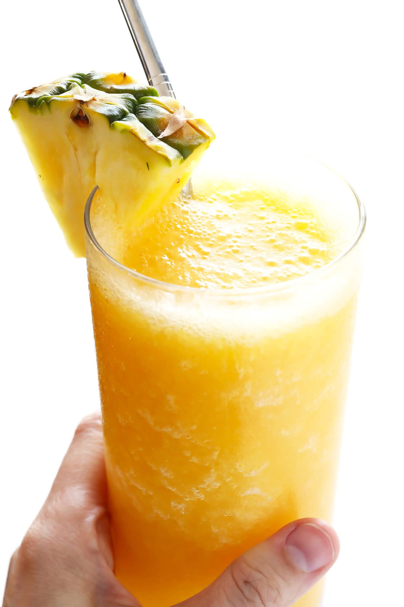 This Tropical Wine Slushies recipe is SO easy...and so delicious. Plus, this frozen cocktail only takes a few minutes to whip up! | gimmesomeoven.com