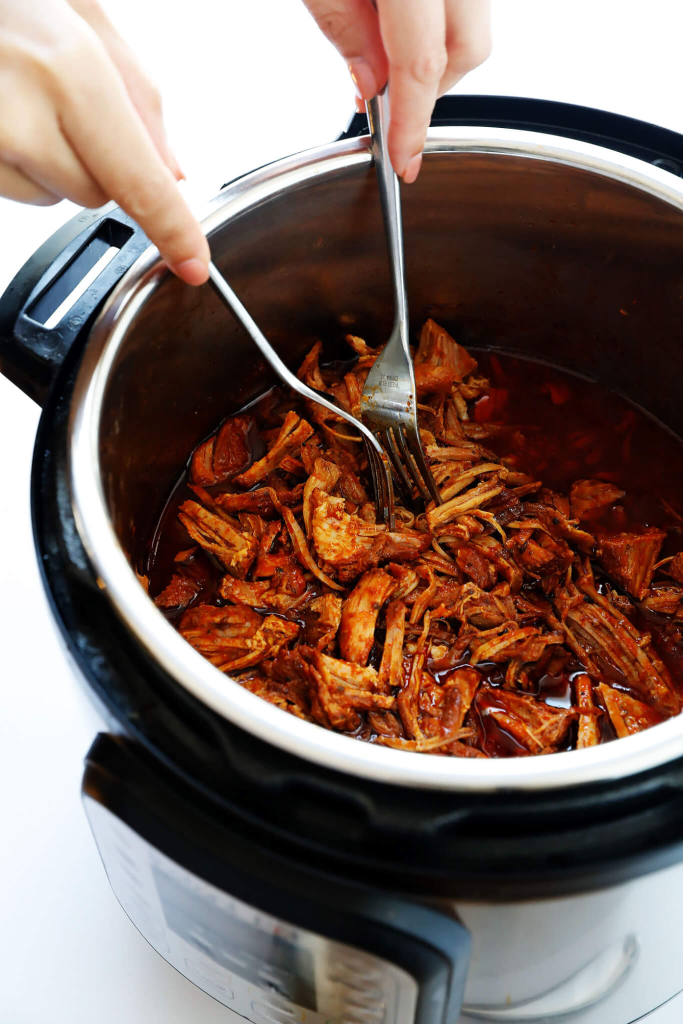 Instant Pot BBQ Pulled Pork! It's easy to make in the pressure cooker, and perfectly juicy and tender and flavorful. | gimmesomeoven.com